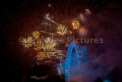 London New Year's Eve Fireworks exploding next to the London Eye