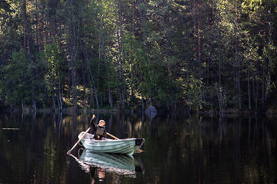 Boy is fishing in Linnansaari National Park