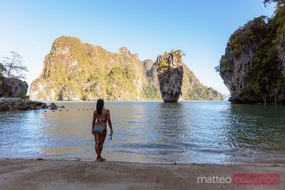 Woman in bikini at James Bond Island, Phang Nga bay, Thailand