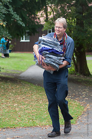 #74586,  Mark Vaughan, Trustee, helping out at the reunion for Summerhill School's 90th birthday celebrations.