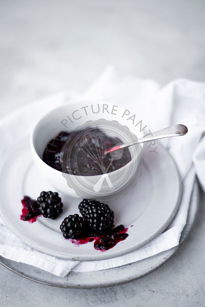 Blackberry Jam On A Simple White Backdrop
