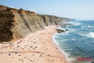 Magoito beach in summer with people, Portugal