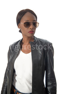 A tough woman, in a leather jacket – shot from eye level.