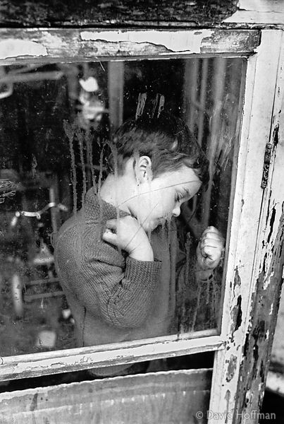 Young boy living in poverty in squatted semi derelict house with his single father, London.