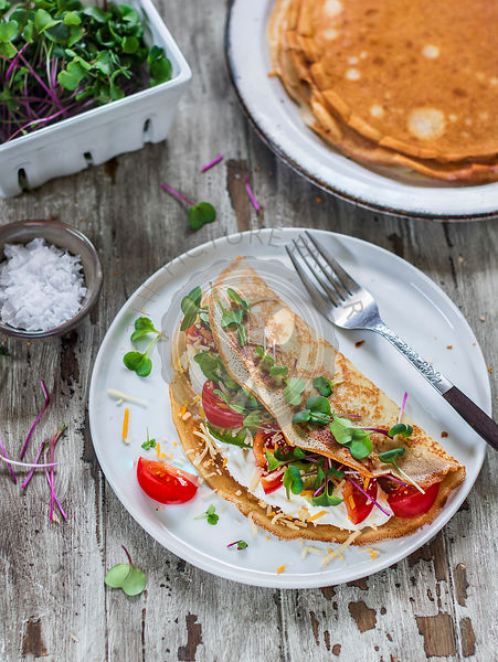 Crepes filled ricotta and vegetables with microgreens