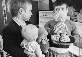 #77333,  Boys with dolls, Vittoria Primary School, Islington, London.  1970.