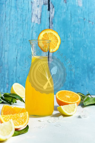 Bottle of fresh orange juice with sliced citrus fruits