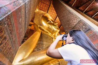 Woman photographing the Reclining Buddha, Wat Pho, Bangkok