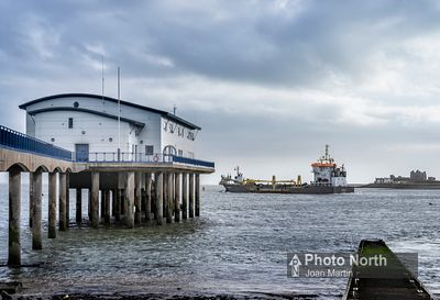 ROA ISLAND 02A - Dredger passing Barrow Lifeboat Station