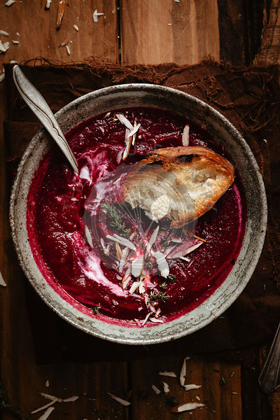 Piece of bread on beet soup