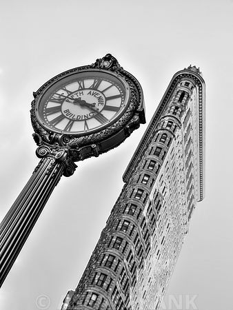 Fifth Avenue Building Clock with Flatiron building - New York