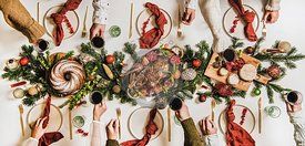 Flat-lay of Festive Christmas table setting and celebrating people