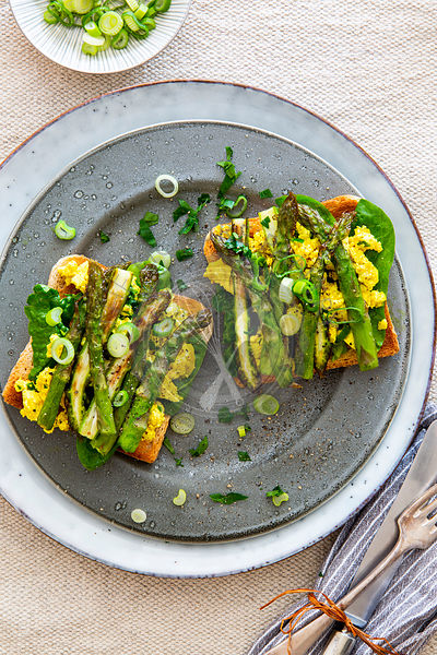 Toast with scrambled tofu and green asparagus