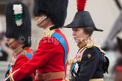 Princess Anne riding with Prince Charles and Prince William on their way down The Mall to the Trooping the Colour Ceremony