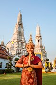 Thai dancer with traditional clothing, smiling, Wat Arun, Bangkok