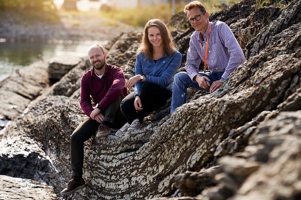 Environmental portrait of three geologists