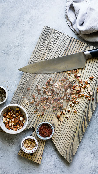 Chopped almonds on a wooden chopping board