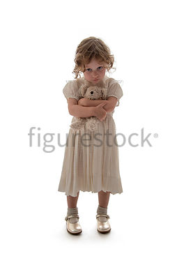 A litle girl holding a teddy – shot from mid level.