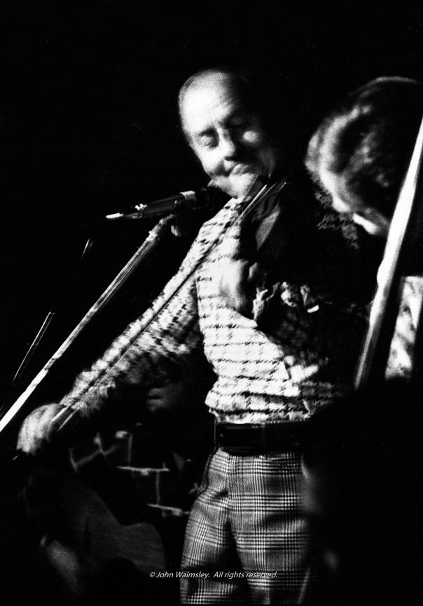 #57722,  Stéphane Grappelli playing in a pub in Putney, London.  1970.