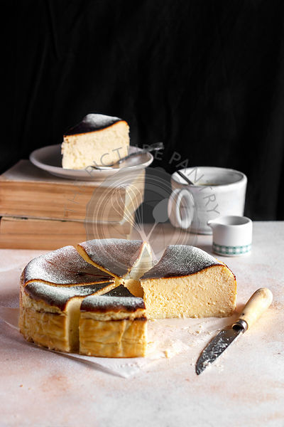 Basque burnt cheesecake with a cup of coffee on the table