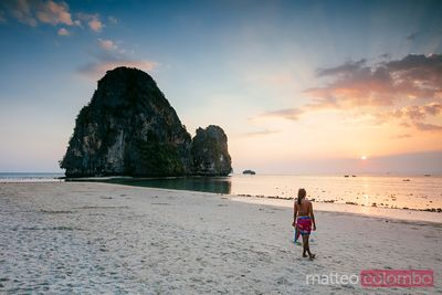 Asian woman at the beach at sunset, Railay, Krabi province, Thailand