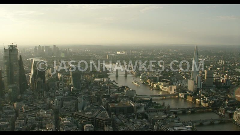 Sunrise aerial footage of the City of London, River Thames, and Shard, London.