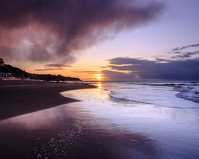 Sunrise_wet_sand_and_rain_clouds_-_Orcombe