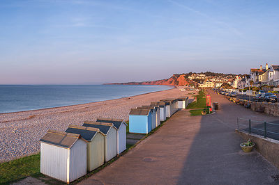 The sea front at Budliegh Salterton in early morning light looking West towards Sandy Bay, Devon, UK