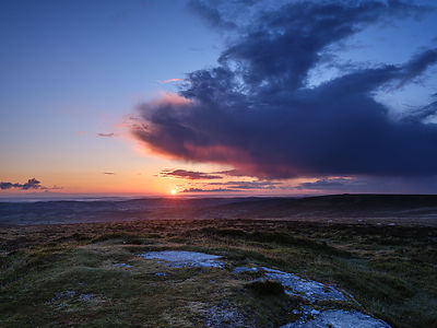 Sun_rising_beneath_big_cloud_-_Hookney_Tor