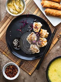 Asian dinner set: pork dumplings, egg rolls and ramen