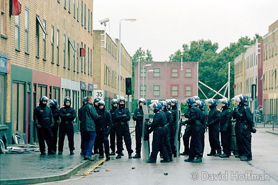 Metropolitan Police public order training centre, Hounslow Heath...Training for tactics to deal with petrol bombs..21 Aug 2002.