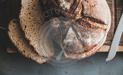 Freshly baked sourdough bread loaf and slices, close-up