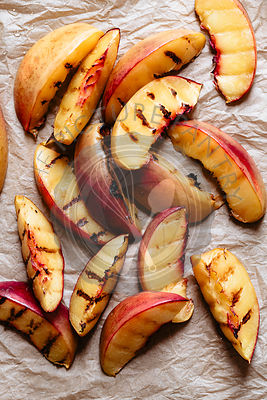 Roasted peaches on parchment  paper
