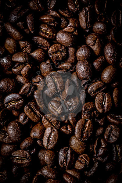 Macro photography of roasted coffee beans.