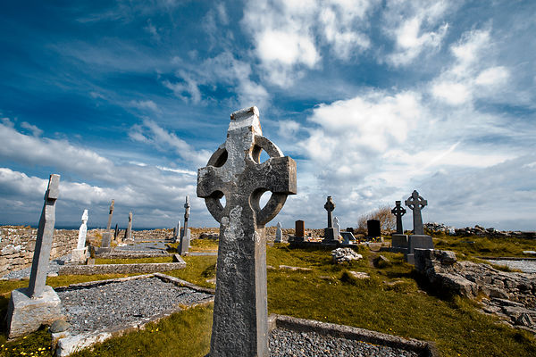 Celtic cross in Na Seacht dTeampaill (Seven Curches) graveyard celtic remains. Inishmore, biggest of Aran Islands. Galway Co....