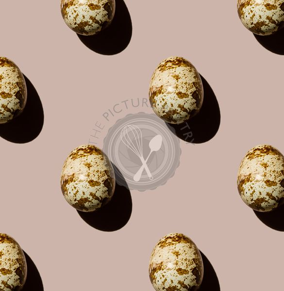 Quail egg on beige background Pattern