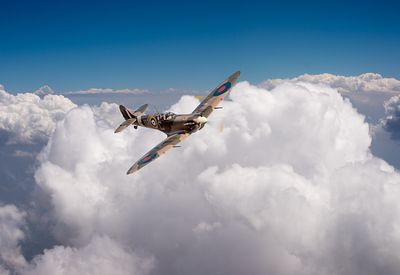 Spitfire above clouds