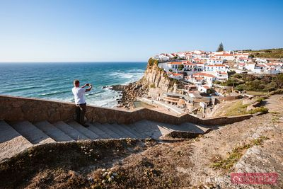 Tourist taking a photo, Azenhas do Mar, Portugal