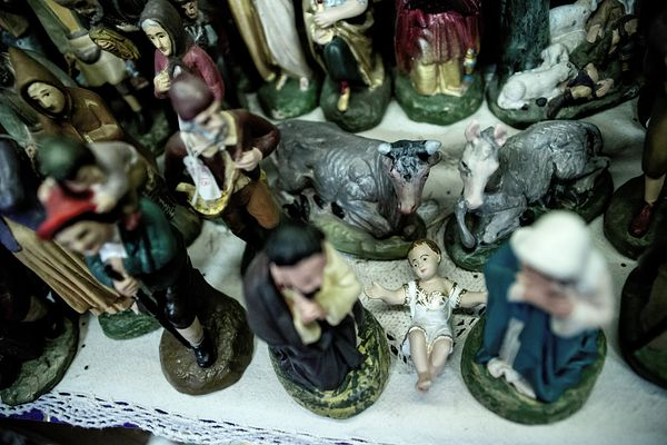 Nativity scene characters on shop shelves.