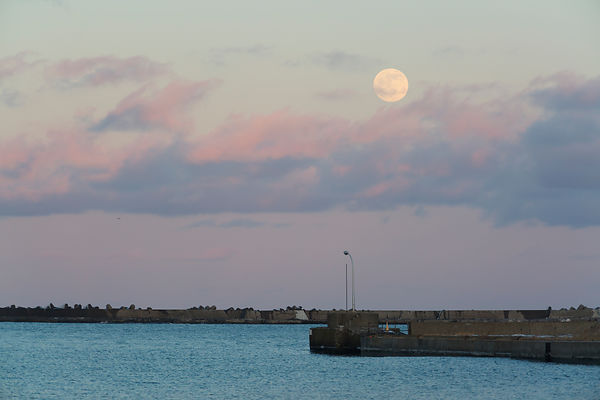 Full moonrise over Abashiri harbor, Hokkaido, Japan