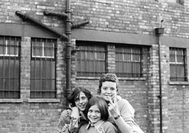 #75020  Having fun outside the building, Liverpool Free School, Liverpool  1971.  Also known as the Scotland Road or Scottie ...