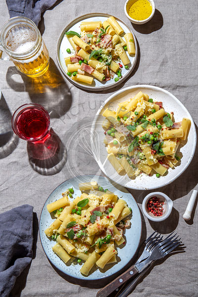 Italian recipe Pasta tortilloni with green pea, mint leaves smoked bacon and cheese