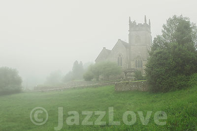 Old church  surrounded by morning fog.