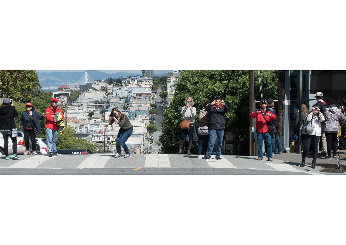 #119856  Tourists photographing the very crooked Lombard Street, San Francisco.