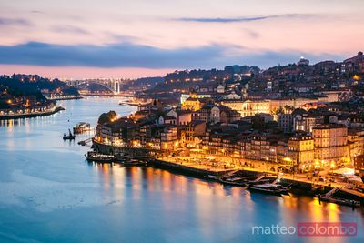 Ribeira waterfront at dusk on Douro river, Porto, Portugal