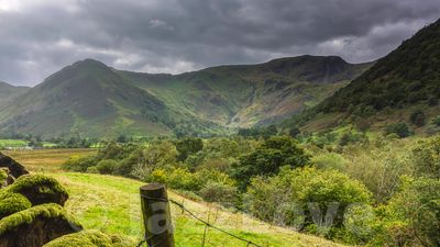 Cloudy sky and sunshine in Patterdale valley