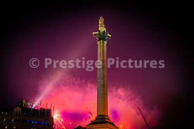 London Fireworks 2020 on News Years Eve as seen from Trafalgar Square - pink sky