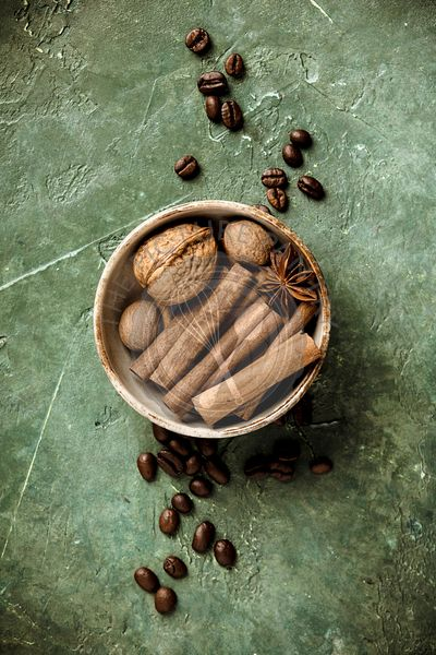 Set of spices and coffee beans on rustic background, flat lay, top view