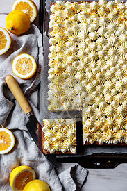 Lemon sheet cake with cream cheese frosting and bee pollen.
