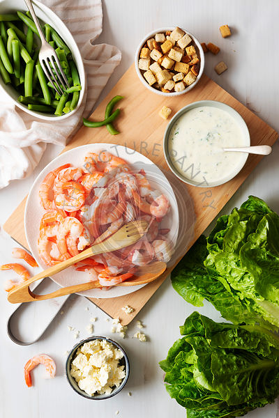 Preparation of ingredients for prawn salad.